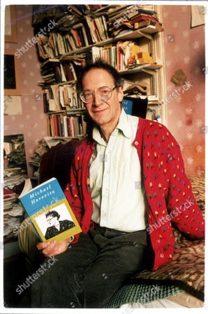 Poet Michael Horovitz In A Nice Flowery Cardigan Posing With A Book He Wrote Himself.