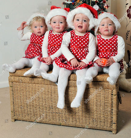 Annabelle Kelly Hannah Kelly Jessica Kelly And Heidi Kelly Are Quads First Ever Born In Britain. The Two Sets Of Ivf Identical Twins Will Be Two Years Old On 27th Dec. Two Pairs Are Hannah Kelly Jessica Kelly And Annabelle Kelly Heidi Kelly Dad And Mum Are Sean Kelly And Lisa Kelly From Billingham Stockton-on-tees With Their Christmas Keeper.