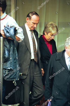 Richard Pearce 53 A Senior Law Society Official At Horseferry Magistrates Court With His Wife. He Has Been Charged With Harassing A Fellow Passenger While Travelling To London From His Home In Hampshire.