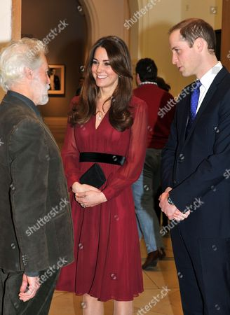 Catherine Duchess of Cambridge and Prince William talk to artist Paul Emsley after viewing his new portrait of her