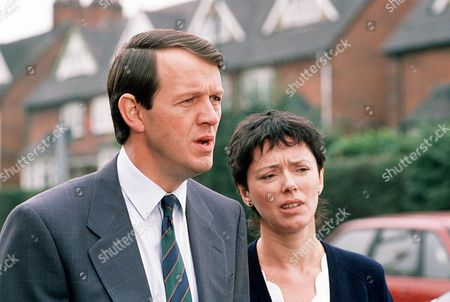 Kevin Whately as Detective Sergeant Lewis and Mary Jo Randle as Detective Sergeant Maitland