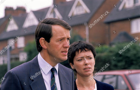 Stock Picture of Kevin Whately as Detective Sergeant Lewis and Mary Jo Randle as Detective Sergeant Maitland