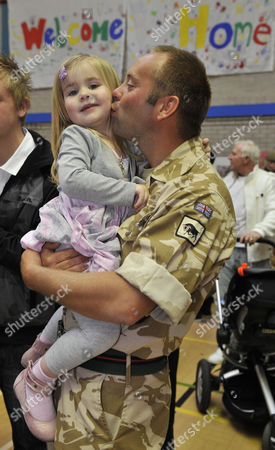 Stock Image of Lance Corporal James Nichols With Daughter Poppy From Chester. Wives Family And Friends Welcome Home Troops From The Yorkshire 2nd Battalion Yorkshire Regt. (the Green Howards) At Weeton Barracks Near Blackpool Lancs.