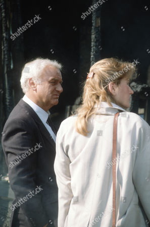 John Thaw as Chief Inspector Morse and Amanda Hillwood as Dr. Grayling Russell, pathologist