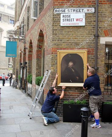 Famous Paintings Being Put Up Around London By The National Gallery The National Gallery Today Challenged Cult Graffiti Artist Banksy By Taking Its Works On To The Streets. It Is Hanging 44 Full-size Recreations On Walls Ranging From Hamleys Toy Shop (a Seurat) To A Sex Shop In Soho (a Caravaggio) To Give Londoners A Taste Of What It Offers. Diners In Lexington Street May Spot Mr And Mrs Andrews By Thomas Gainsborough While Theatre-goers Can See A Turner At The Palace Theatre In Romilly Street Or A Rembrandt At The Queen's In Wardour Street. Artists From Botticelli To Holbein And Michelangelo Are Among Those To Be Seen At Locations Around Soho Over The Next 12 Weeks. The Initiative Is Named The Grand Tour After The Cultural Trips To The Continent Undertaken From The 17th Century By The Upper-classes. Art Critic Andrew Graham-dixon Said The New Initiative Was A 'creative And Innovative Billboard Campaign' To Remind People What A Great Resource The National Gallery Was. 'anything Banksy Can Do The National Gallery Can Do Better. 'i Suppose These Images Do Invite Banksy-type Interventions But I'm Assured That They Are Apparently Graffiti-proof.' All Have Been Reproduced Using The Latest Technology From Project Sponsors. Hewlett-packard. Each Picture Is Framed And Has An Information Plaque Like The Ones In The Gallery. Passers-by Can Call A Number For An Audio Guide To Each Work. Charles Saumarez Smith Director Of The National Gallery Said: 'i Think They're Surprisingly Effective. I Saw The Joseph Wright Of Derby And It Was Very Unexpected To Come Down Frith Street And Suddenly See A Picture Hanging On A Brick Wall Not In An Art Gallery But Framed As If In A Gallery. 'it Does Jolt One And Make You Look And Think Even Me. They're Sufficiently High Quality On A Photographic Equivalent Of Canvas And They Are Framed In Such A Way That They Don't Look Like Posters. 'it's Much More Like Seeing A Work Of Art In The National Gallery Than Seeing A Poster On The Undergro.