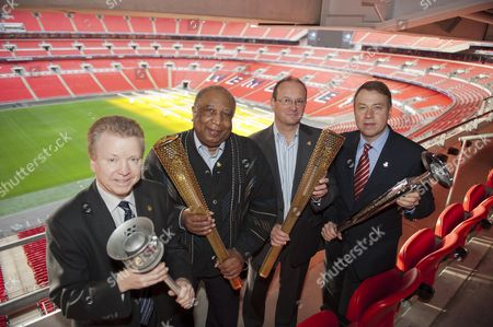 Lord Colin Moynihan Holding The 1948 Torch Jim Redmond And Paul Mears Holding 2012 Torches And Ceo Andy Hunt Holding The 1992 Barcelona Games Torch Boa Celebrate Olympians Volunteers And Parents As London 2012 Torchbearers At Wembley Stadium London. Picture By Glenn Copus.