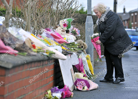 Flowers Are Brought To The Scene Of A House Fire In Freckleton Lancs Which Killed Four Year Old Twins Holly Smith And Ella Smith Jordan Smith 2 And Brother Reece Smith 19.  9.1.12.