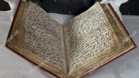 British Library Senior Conservator David Jacobs With The Ma'il Qu'ran Dating From The 8th Century And One Of The Earliest In Existence And Will Form Part Of A New Exhibition Hajj: Journey To The Heart Of Islam At The British Museum Picture By Glenn Copus.