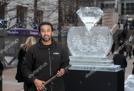 Sculptor Asanga Amerasinghe Has Created A Giant Diamond Out Of Ice. The Sculpture Is Part Of The London Ice Sculpting Festival In Canary Wharf And Also To Celebrate The Queen's Diamond Jubilee Year.
