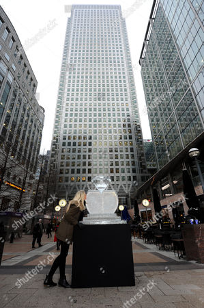 Amy Rackham Stops To Take A Closer Look At The Ice Sculpture Created By Sculptor Asanga Amerasinghe . The Sculpture Is Part Of The London Ice Sculpting Festival In Canary Wharf And Also To Celebrate The Queen's Diamond Jubilee Year.