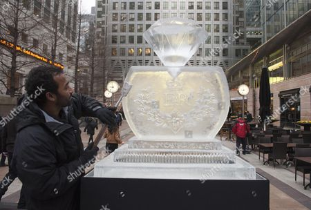Editorial picture of Ice Sculptor Asanga Amerasinghe Of Icebox Puts The Finishing Touched To A Giant Diamond To Launch The London Ice Sculpting Festival At Canary Wharf Today Picture By Glenn Copus.