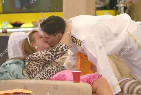 Stock Picture of Tricia Penrose kissing Rylan Clark after he read her letter from home