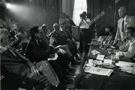 Meeting With March Leaders -- A. Philip Randolph (Standing Right), Negro Labor Leader And Originator Of The 'march On Washington' Idea, And Cleveland Robinson (Seated Right), Chairman Of The March Administrative Committee, Answer Questions Of Congressional Leaders At The Capitol In Washington August 7. Randolph Outlined In Detail The Plans For The August 28th Demonstration March In Support Of President Kennedy's Civil Rights Legislation. Seated In The Front Row At Left Are Senators Paul Douglas Of Illinois, Philip A. Hart Of Michigan And Kenneth Keating Of New York. Seated Second From Right In The Front Row Is Congressman James Roosevelt Of California. More Than 60 Senators And Representative Attended The Meeting