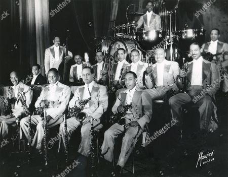 1930's - Duke Ellington's Original Big Band. Ellington At Left At Piano. Band Personnel: Otto Hardwick - Sax Harry Carney - Sax Barney Bigard - Sax Johnny Hodges - Sax Wellman Braud - Bass Joe (Tricky Sam) Nanton, Trombone Juan Tizol - Trombone Lawrence Brown - Trombone Rex Stewart - Trumpet Cootie Williams - Trumpet Arthur Wetzel - Trumpet Sonny Greer - Drums Fredie Guy - Guitar