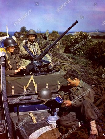 England, June 1944 - Three Soldiers On Top Of A Half Track Give Last Minute Check On Gun And Equipment Prior To Boarding A Ship For The Invasion (D Day). Cpl. John Hartledge, Breese, Illinois, Cpl. Edward L. Smith, St. Paul, Minnesota, Pvt. George Roberts, Herndon, Va