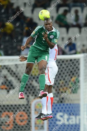 Nigeria player Aide Brown Ideye fights for the ball in aerial play with Burkina Faso player Mady Saidou Panandetiguiri
