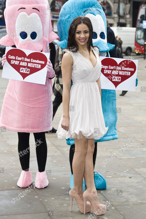 Lacey Banghard with PETA giant condoms