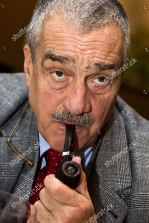 Stock Photo of Karel Schwarzenberg smoking his pipe during an interview