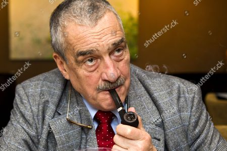 Stock Picture of Karel Schwarzenberg smoking his pipe during an interview