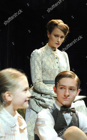 Emilia Jones as Flora, Anna Madeley as the Governess, Laurence Belcher as Miles
