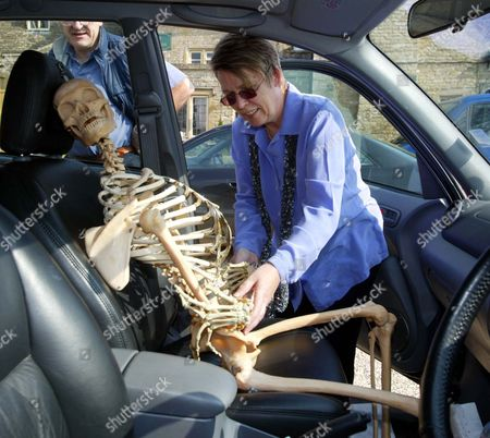 Judy Shaw Places A Skeleton On The Front Seat Of Her Car For The Journey Home From The Auction Of Property Owned By John Entwistle The Former Bass Guitarist With 'the Who' At Frogmill Hotel Andoversford Gloucestershire.