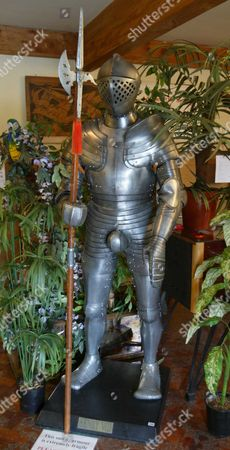 A Henry Viii Replica Suit Of Armour Among The Lots At The Auction Of Property Owned By John Entwistle The Former Bass Guitarist With 'the Who' At Frogmill Hotel Andoversford Gloucestershire.
