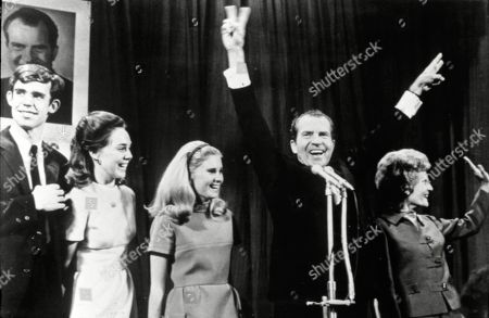 Nixon Eisenhower President-elect Richard Nixon and his wife, Pat, were a picture of joy at the Waldorf-Astoria Hotel in New York, as he thanked campaign workers. At left are David Eisenhower, Julie Nixon's fiance, Julie and her sister Tricia at center