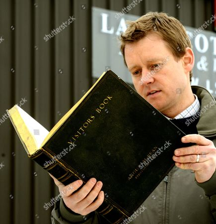 Auctioneer Eddie Crichton with the book