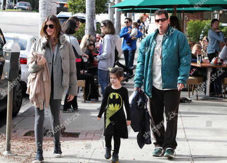 Stock Image of Adam Sandler with wife Jackie Sandler and daughter Sunny Sandler