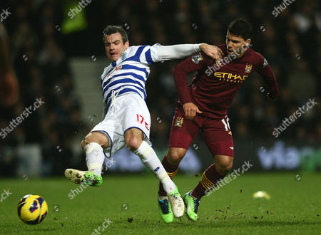 Queens Park Rangers' Ryan Nelsen battles with Manchester City's Sergio Aguero