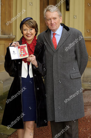 Lady Catherine Meyer awarded a CBE for services to children and families with her husband Sir Christopher Meyer