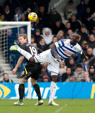 Stock Photo of Christopher Samba of QPR and Luciano Becchio of Norwich City