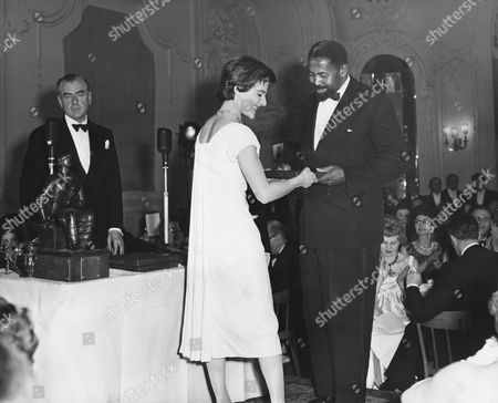 YVONNE MITCHELL presents the award to REX INGRAM on behalf of SIDNEY POITIER for the 1958 FOREIGN ACTOR Award for his performance in THE DEFIANT ONES (the Film also won the UN AWARD) at the Awards Ceremony in 1959