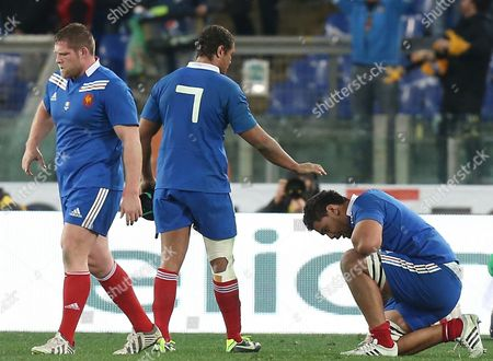 Stock Photo of The dejection of Vincent Bebaty, Thierry Dusatoir and Romain Taofifenua at the final whistle