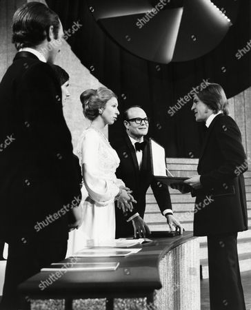 CAPTAIN MARK PHILLIPS, IAN MARTIN (SFTA VICE CHAIRMAN OF TELEVISION), HRH THE PRINCESS ANNE (PRESIDENT OF THE SFTA) and SYDNEY SAMUELSON (CHAIRMAN OF THE SFTA) with ALAN PRICE winner of the 1973 ANTHONY ASQUITH Award (FILM MUSIC) for O LUCKY MAN! (1973) at the Awards Ceremony in 1974