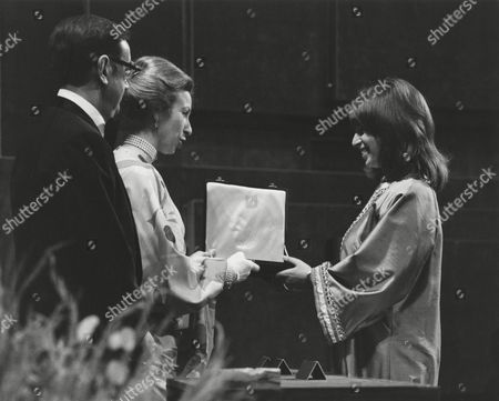 NORMA SHEPPARD (MRS BERNARD HERRMANN) accepting the 1976 ANTHONY ASQUITH Award for TAXI DRIVER (1976) on behalf of her late husband BERNARD HERRMANN presented by OZZY MORRIS (ACADEMY VICE CHAIRMAN OF FILM) and HRH THE PRINCESS ANNE (PRESIDENT OF THE ACADEMY) at the Awards Ceremony in 1977