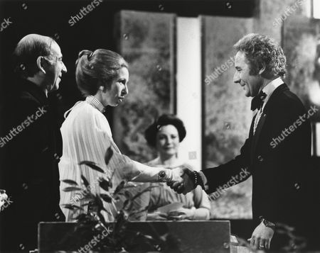 DEREK MEDDINGS (one of the special effects team for SUPERMAN) winners of the 1978 MICHAEL BALCON Award presented by HRH THE PRINCESS ANNE (PRESIDENT OF THE ACADEMY) and DAVID DEUTSCH (ACADEMY VICE CHAIRMAN OF FILM) with JILL BALCON at the Awards Ceremony ini 1979