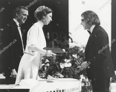 ANDRE PREVIN accepting the 1979 ANTHONY ASQUITH Award on behalf of ENNIO MORRICONE for DAYS OF HEAVEN (1979) presented by HRH THE PRINCESS ANNE (PRESIDENT OF THE ACADEMY) and TIMOTHY BURRILL (ACADEMY VICE CHAIRMAN OF FILM) at the Awards Ceremony in 1980