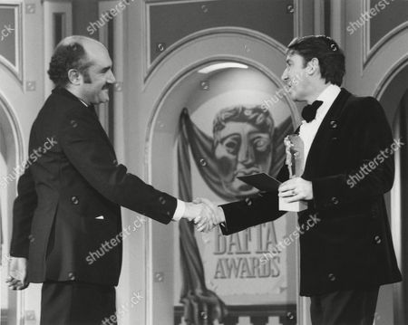 Stock Image of REX BLOOMSTEIN winner of the 1980 FACTUAL SERIES Award for STRANGEWAYS presented by DAVID STEELE at the Awards Ceremony in 1981