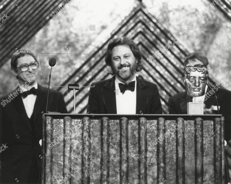 DAVID PUTNAM winner of the 1981 MICHAEL BALCON Award with JOHN BOULTING and RAY BOULTING (citation readers) at the Awards Ceremony in 1982
