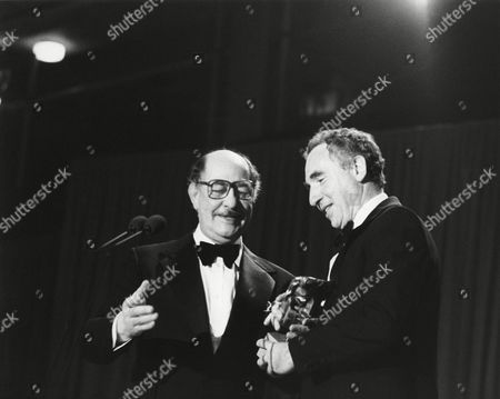 NIGEL HAWTHORNE winner of the 1982 LIGHT ENTERTAINMENT PERFORMANCE for YES, MINISTER (1982) presented by ALFRED MARKS (citation reader) at the Awards Ceremony in 1983