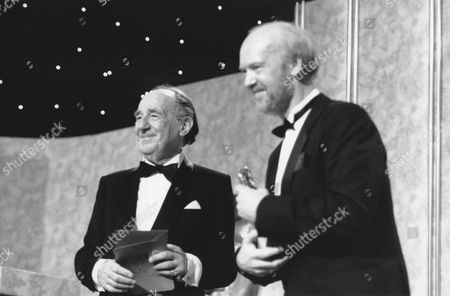 (right) MICK JACKSON winner of the 1987 SINGLE DRAMA Award for LIFESTORY (1987) presented by MICHAEL HORDERN (citation reader) at the Awards Ceremony in 1988
