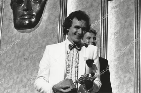 MICHAEL BEYNON winner of the 1987 CHILDREN'S PROGRAMME (FACTUAL) Award for THE REALLY WILD SHOW (1987) presented by STEVE CRAM (citation reader) at the Awards Ceremony in 1988
