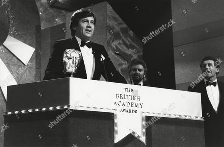 MELVYN BRAGG (citaiton reader) with NOEL EDMUNDS (PRESENTER) and KEVIN BILLINGTON (CHAIRMAN OF THE ACADEMY) at the Awards Ceremony in 1991