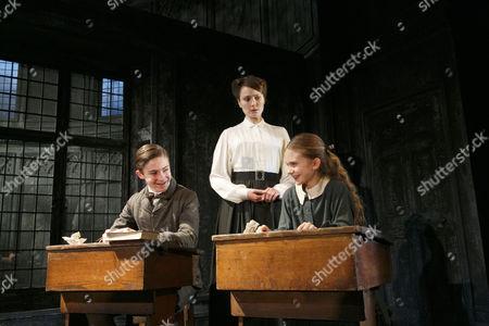 Stock Image of Laurence Belcher (Miles), Anna Madeley (Governess), Emilia Jones (Flora)