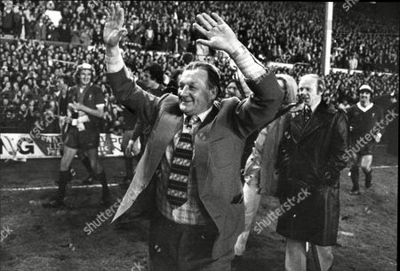 Liverpool Manager Bob Paisley Salutes The Fans After Winning The League Commentator Tony Gubba Behind Him Liverpool V Aston Villa 3-0 Robert Paisley Obe (23 January 1919 A 14 February 1996) Was An English Footballer And Manager Who Spent Almost Fifty Years With Liverpool As A Right-back Physiotherapist Coach And Finally Manager. In Nine Years As Manager Paisley Led Liverpool To Win Twenty Honours A Six First Division Championships Three League Cups Six Fa Charity Shields Three European Cups One Uefa Cup And One Uefa Super Cup. He Is Often Cited As One Of The Greatest Football Managers Of All Time And Is To Date The Only Manager In History To Have Won Three European Cups.