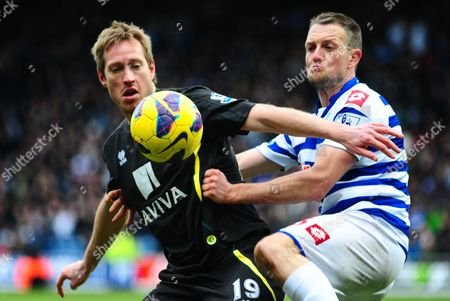 Clint Hill of QPR battles with Luciano Becchio of Norwich City