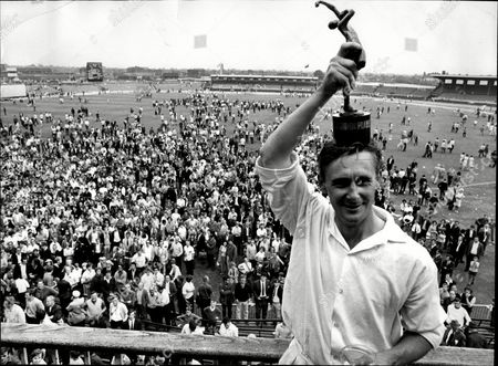 Cricketer Jack Bond With Cup After Winning The Sunday League With Lancashire John David 'jack' Bond Born In Kearsley Near Bolton Lancashire On 6 May 1932 Is A Former Cricketer Who Played For Lancashire And For One Season For Nottinghamshire. Jack Bond Was A Right-handed Middle Order Batsman And A Good Close Fielder Who Had A Fairly Unspectacular County Cricket Career For Lancashire From 1955 Being Assured Of A Regular Place In A Strong Batting Line-up In Only A Few Seasons Among Them 1962 When He Scored 2 125 Runs At An Average Of More Than 36. But By The Mid-1960s He Was Second Eleven Captain And An Irregular First-class Cricketer. Success With The Second Team Though Led To An Unexpected Call-up To Be First Team Captain From 1968 And Over The Next Five Seasons Bond Led A Previously Under-achieving Side To A Run Of Success In One-day Cricket Competitions That Has Not Been Equalled. Intensively Competitive Bond Led By Example In The Field And Often Made Useful Runs Normally Batting At No 6 Or Lower. A Mostly Young Team Included Future England Cricketers Such As Barry Wood David Lloyd Frank Hayes Peter Lever And Ken Shuttleworth And Lancashire Recruited Proven Matchwinners In Clive Lloyd And Farokh Engineer As The Overseas Stars.