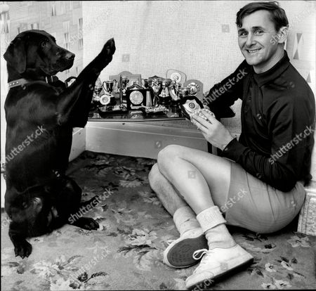 Cricketer Jack Bond With Pot Dog John David 'jack' Bond Born In Kearsley Near Bolton Lancashire On 6 May 1932 Is A Former Cricketer Who Played For Lancashire And For One Season For Nottinghamshire. Jack Bond Was A Right-handed Middle Order Batsman And A Good Close Fielder Who Had A Fairly Unspectacular County Cricket Career For Lancashire From 1955 Being Assured Of A Regular Place In A Strong Batting Line-up In Only A Few Seasons Among Them 1962 When He Scored 2 125 Runs At An Average Of More Than 36. But By The Mid-1960s He Was Second Eleven Captain And An Irregular First-class Cricketer. Success With The Second Team Though Led To An Unexpected Call-up To Be First Team Captain From 1968 And Over The Next Five Seasons Bond Led A Previously Under-achieving Side To A Run Of Success In One-day Cricket Competitions That Has Not Been Equalled. Intensively Competitive Bond Led By Example In The Field And Often Made Useful Runs Normally Batting At No 6 Or Lower. A Mostly Young Team Included Future England Cricketers Such As Barry Wood David Lloyd Frank Hayes Peter Lever And Ken Shuttleworth And Lancashire Recruited Proven Matchwinners In Clive Lloyd And Farokh Engineer As The Overseas Stars.