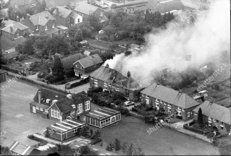 Aerial View Of Hungerford Taken During Or Shortly After The Shooting Spree By Michael Ryan. Shows 4 South View Ryan's House On Fire. The Hungerford Massacre On 19 August 1987. The Gunman 27-year-old Michael Robert Ryan Armed With Two Semi-automatic Rifles And A Handgun Shot And Killed Sixteen People Including His Mother And Wounded Fifteen Others Then Fatally Shot Himself. Taken From Book 'true Crime' Classic Rare And Unseen. Published By Trans Atlantic Press 2009.